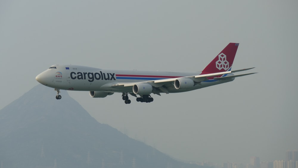 white, red, and blue Cargolux airplane in flight