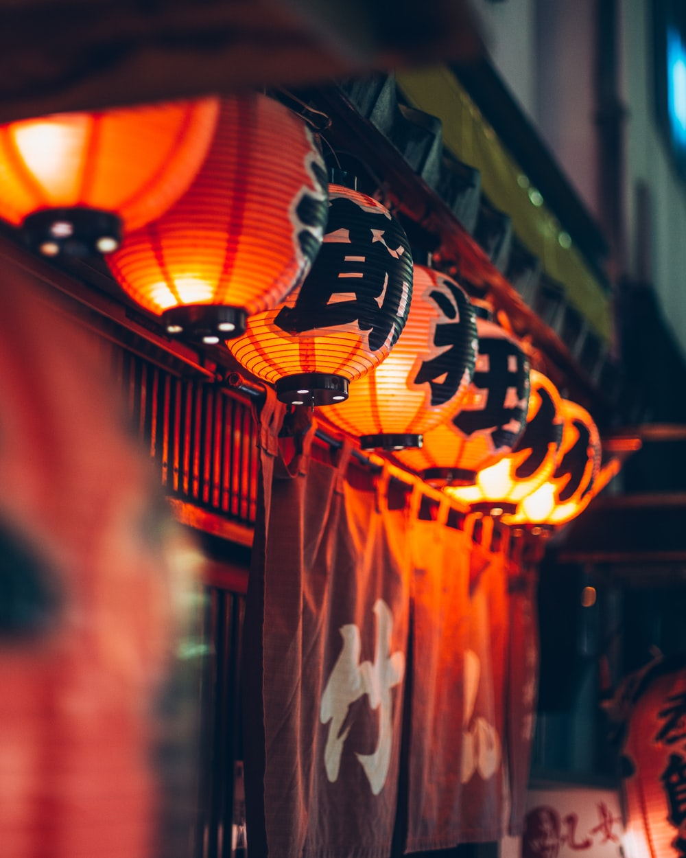 selective focus photography of red-and-black Chinese lanterns