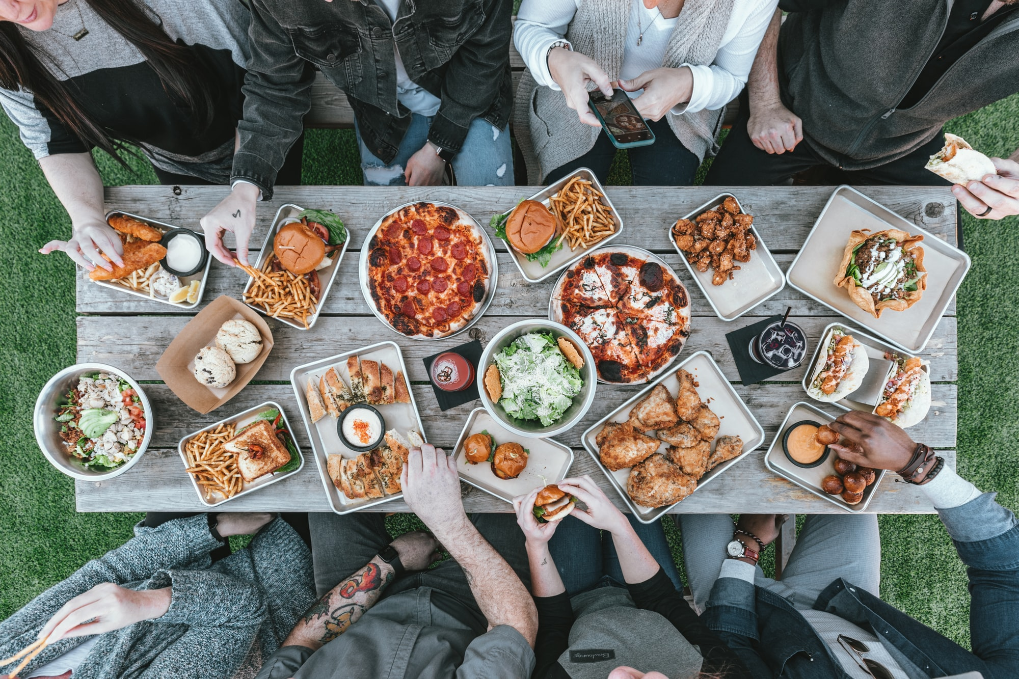 Being vegan for life means the some parties might not have many vegan options  by Spencer Davis for Unsplash.
