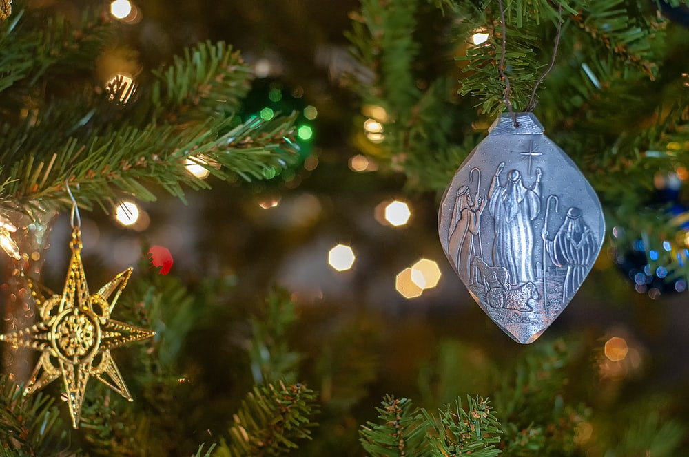 selective focus photography of ornaments hanged on green pine tree