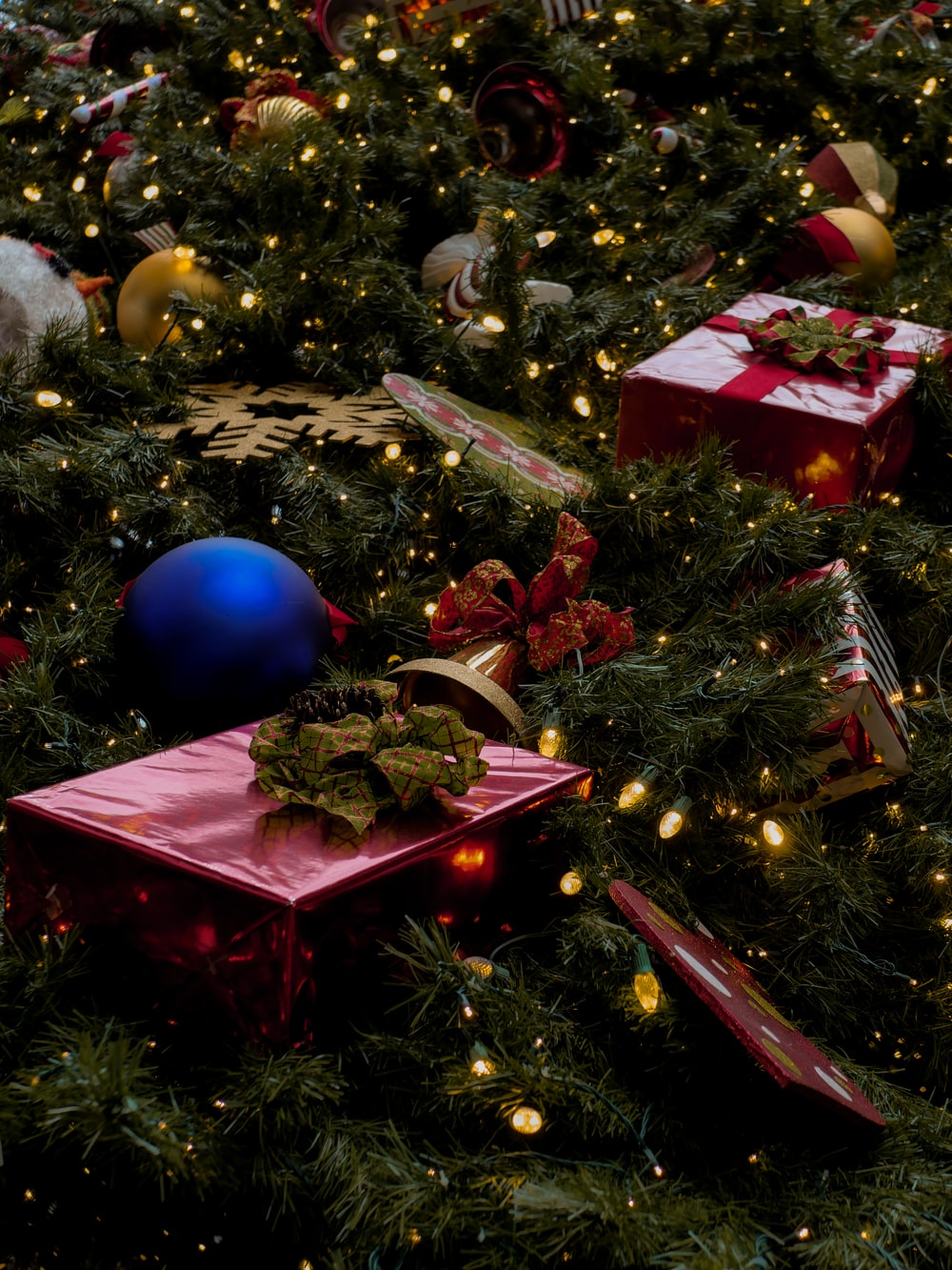selective focus photography of baubles on Christmas tree