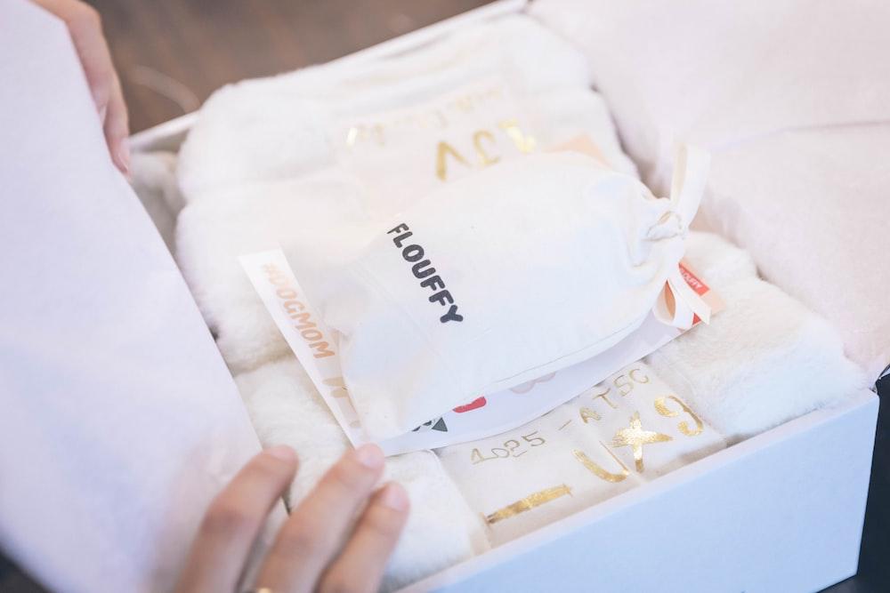white Flouffy pouch on box