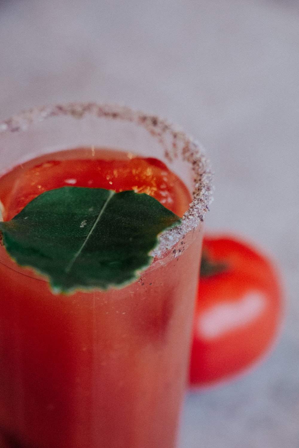 clear drinking glass with tomato juice