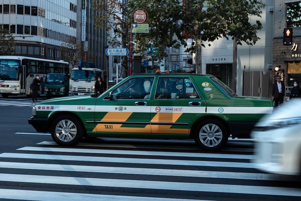 green cab on pedestrian lane