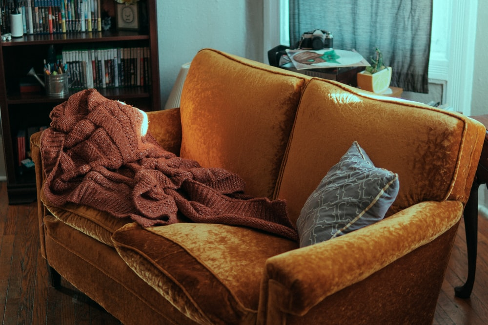 blanket and pillow on sofa
