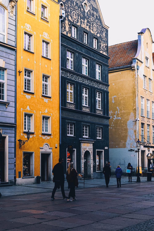 people walking beside building during daytime