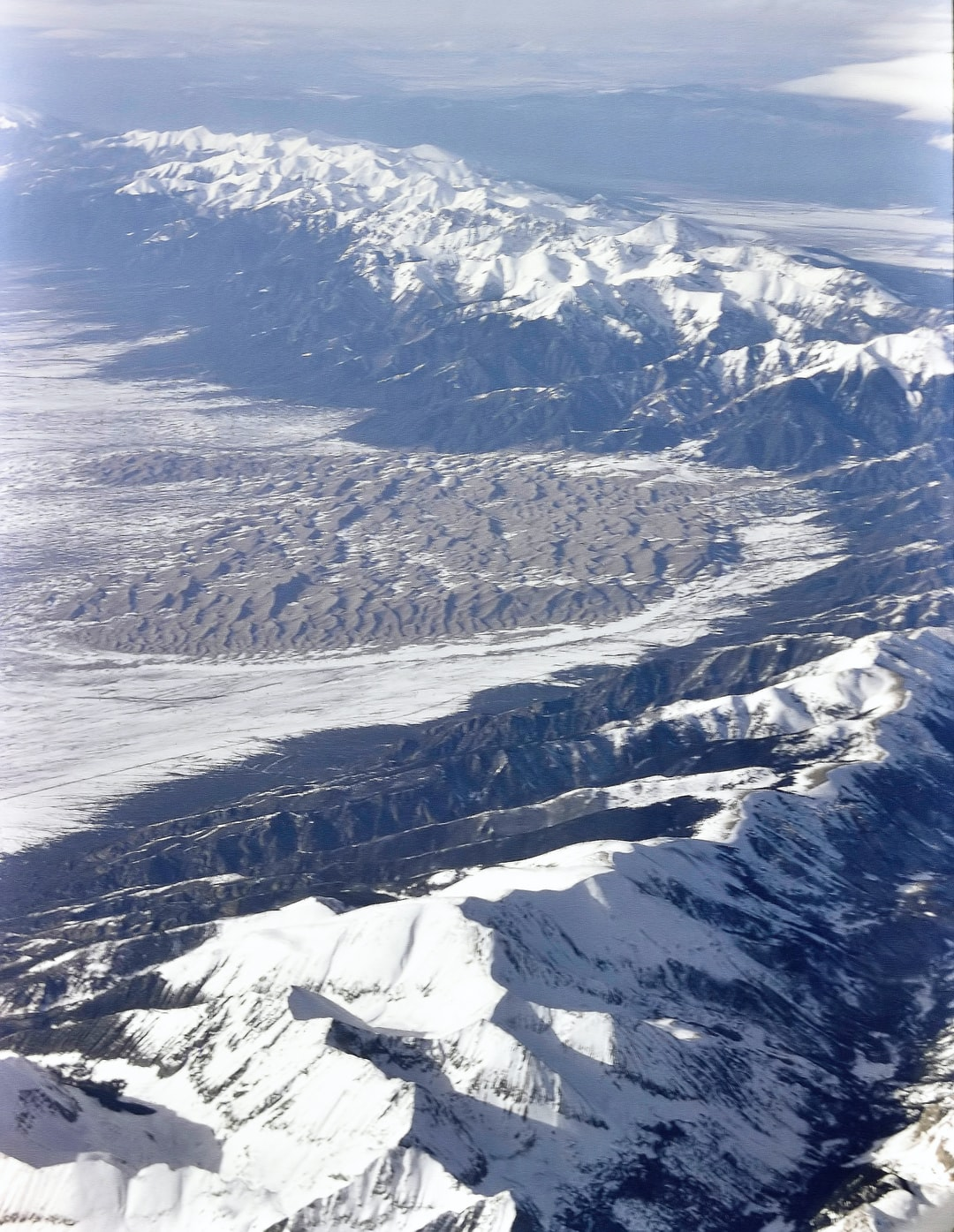 "The Great Dunes national park Colorado. With the Rocky Mountains ""Sangre De Cristo"" mountain range. One of a lucky set of photos. taken on a flight from Chicago to Phoenix, March 1992. (This is a Digital photo from my original 1992 ""Slide"".) I have set up a slide copy ""Rig"" using my Nikon D7200 + close up lens."