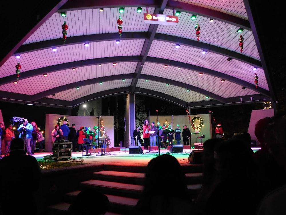 people on lighted stage