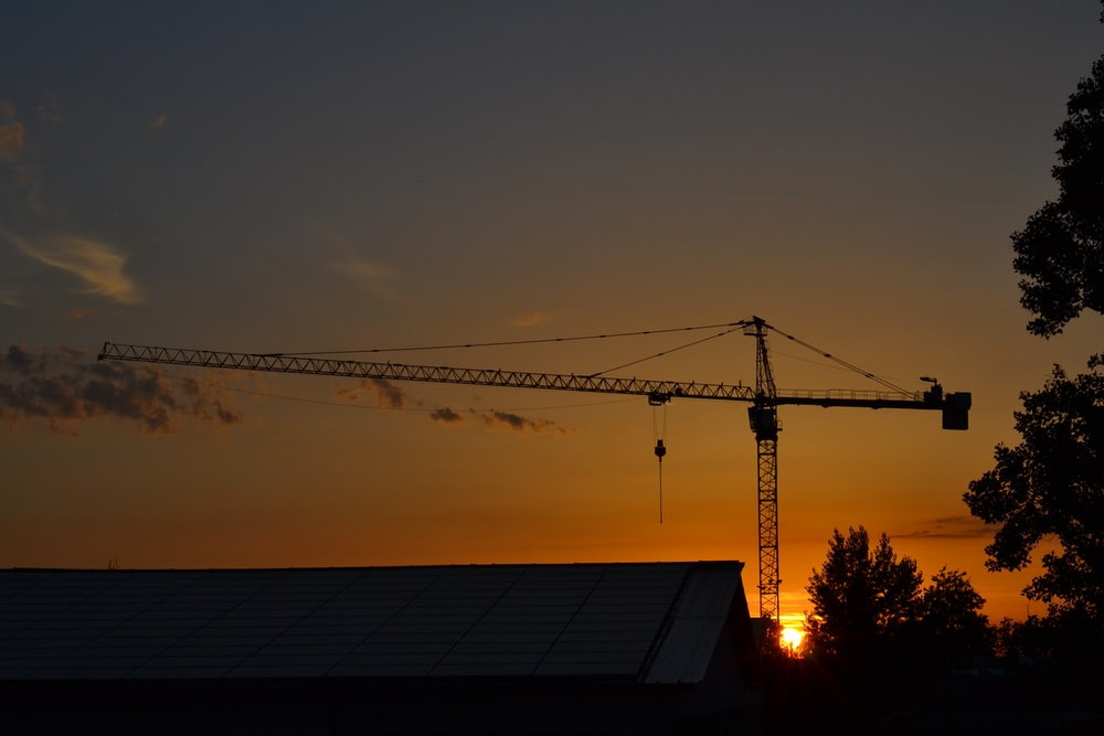 gray tower crane during golden hour