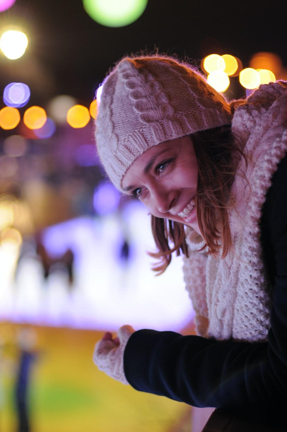 woman wearing white knit cap