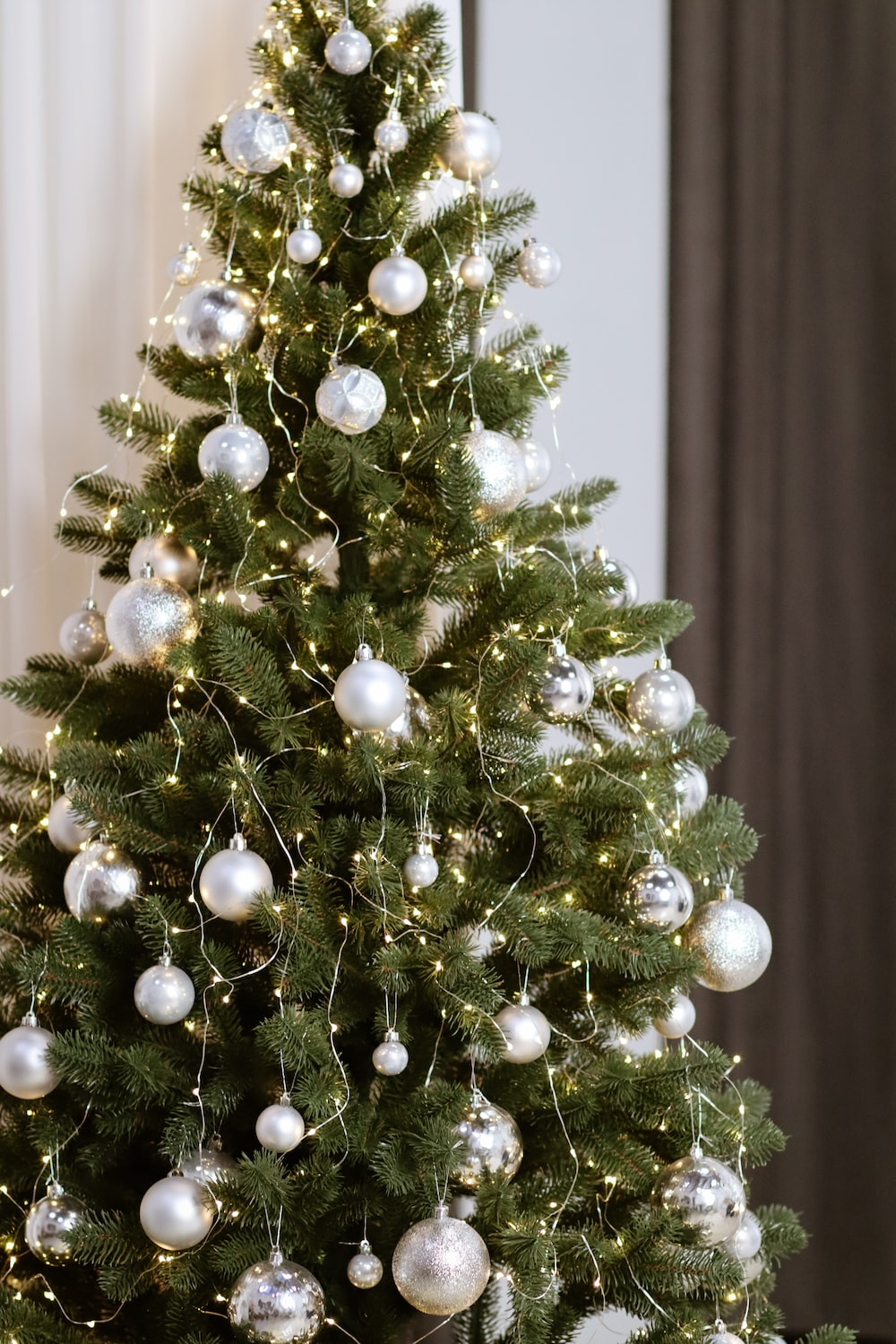 green Christmas tree with gray baubles