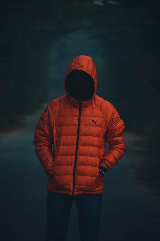 man wearing red Puma bubble coat