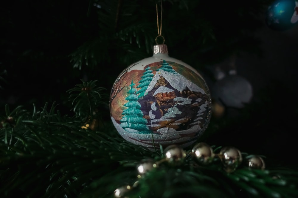 white, brown, and teal bauble ball