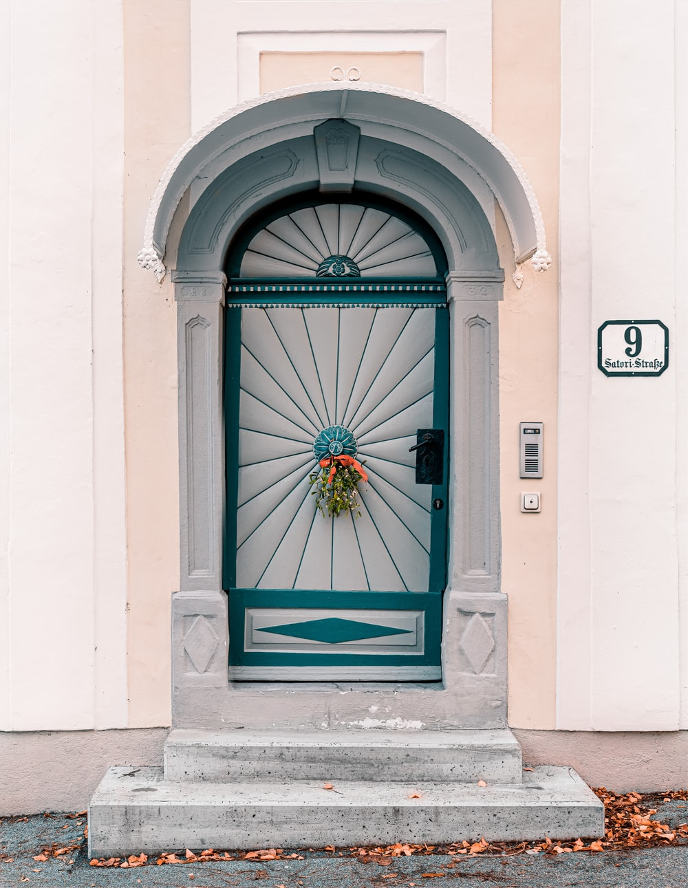 white and teal wooden door