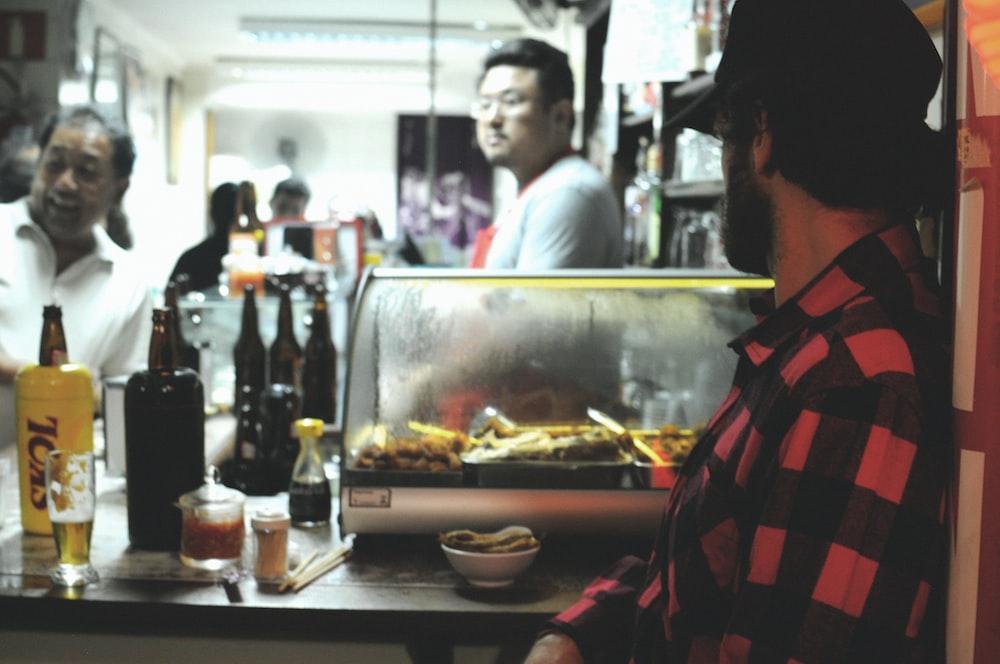 man facing food stall