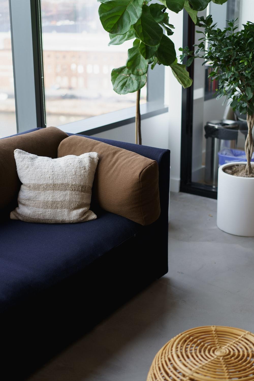 white and brown throw pillow on sofa