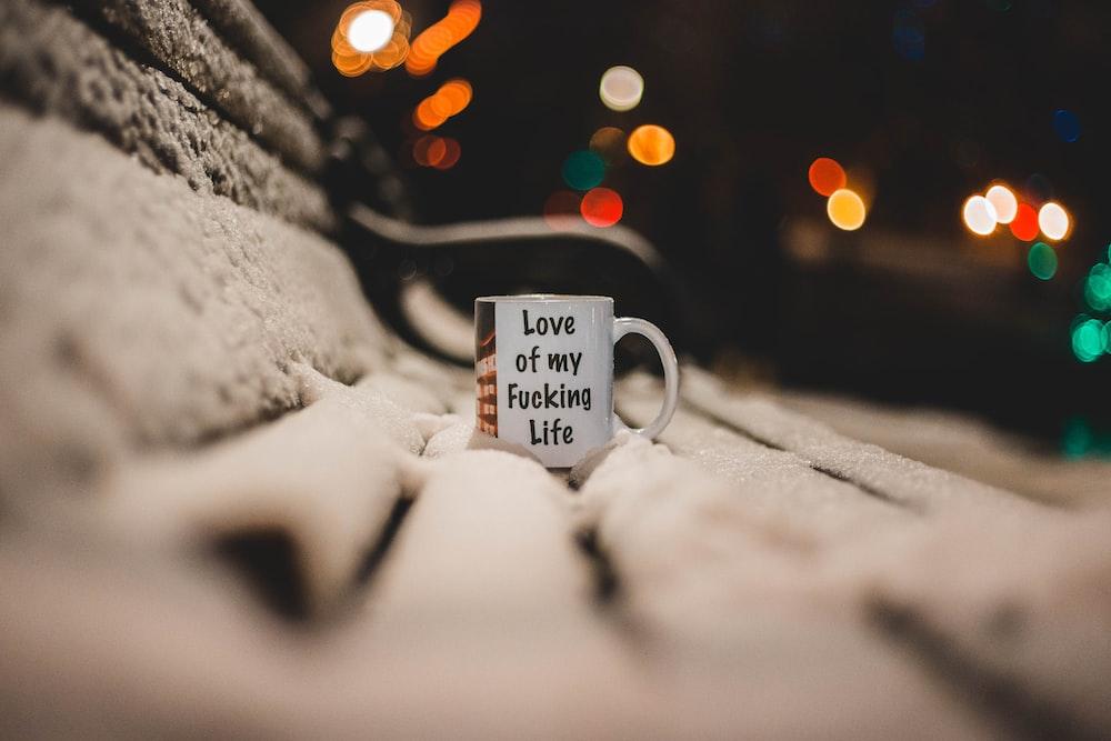 white ceramic mug on bench
