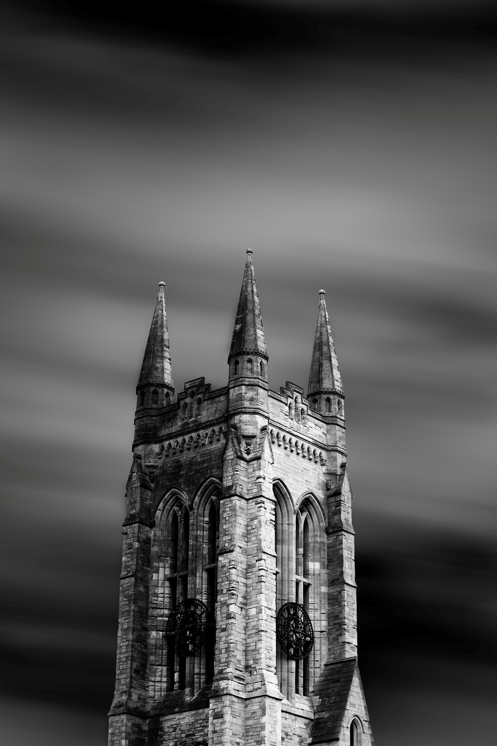 grayscale photo of castle tower
