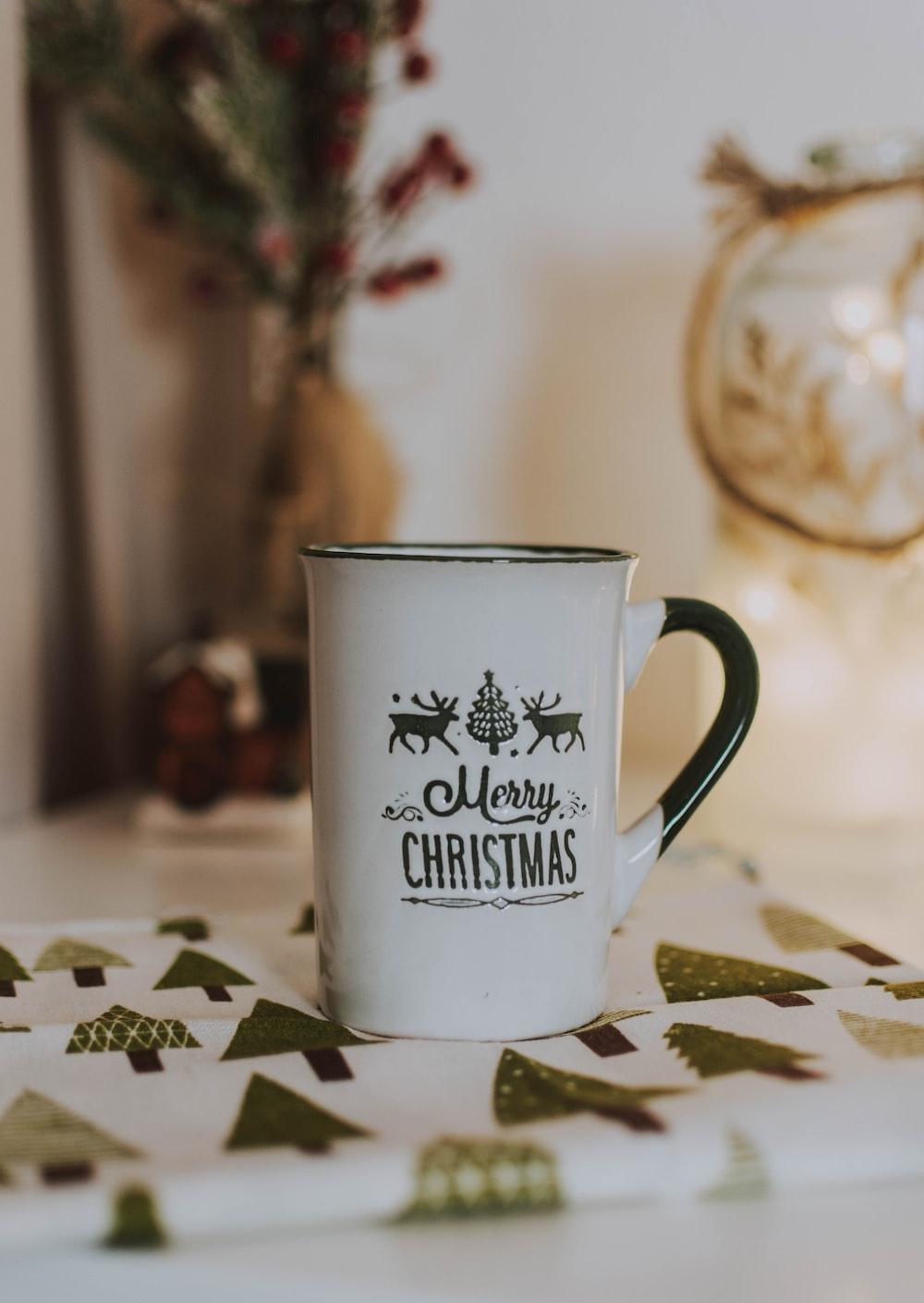 white and black Merry Christmas-painted mug
