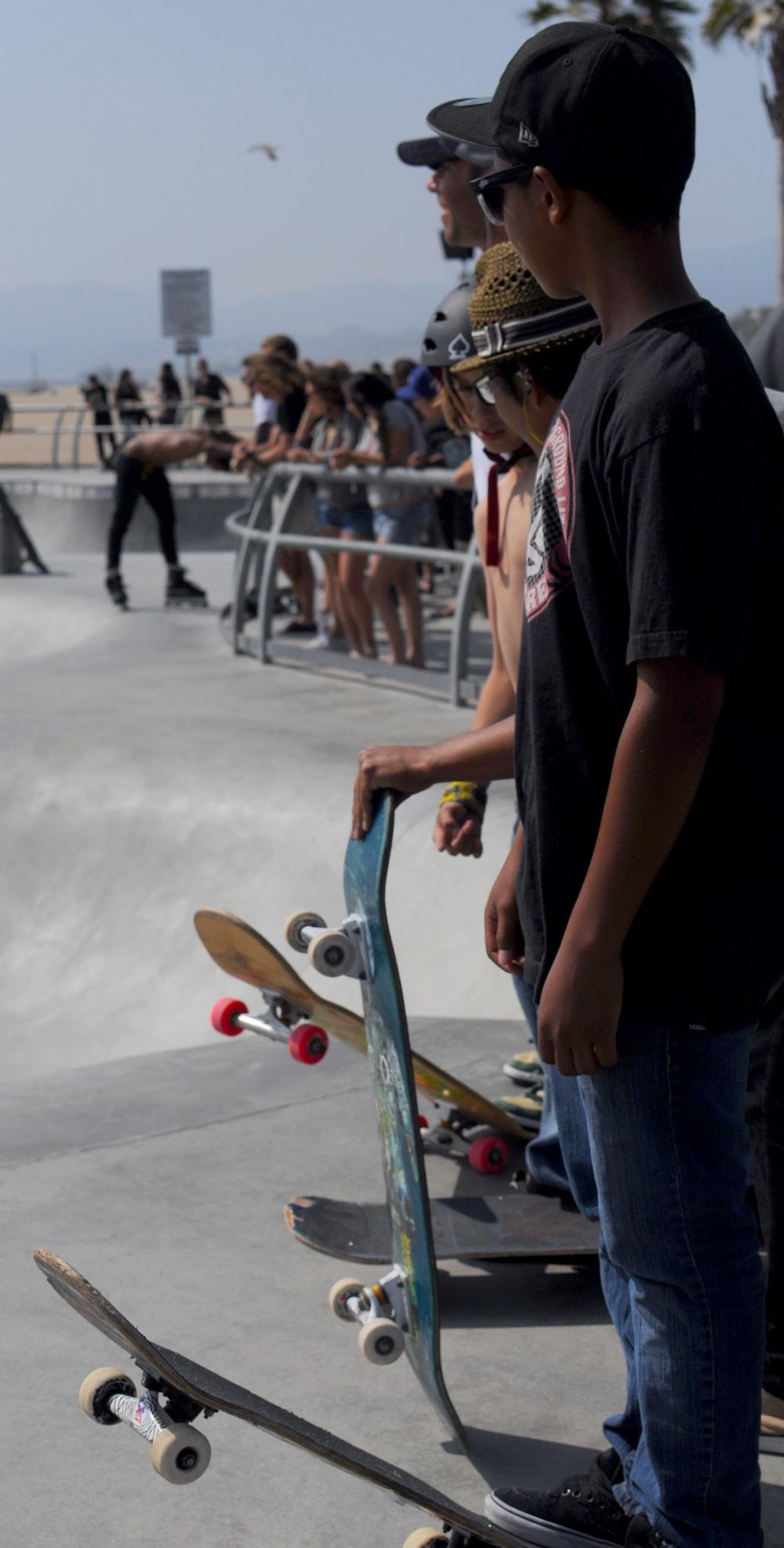 men holding skateboard