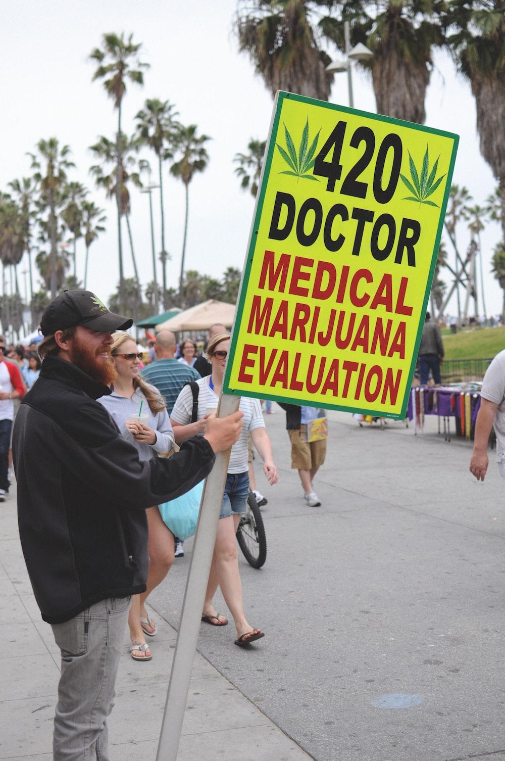 man holding banner