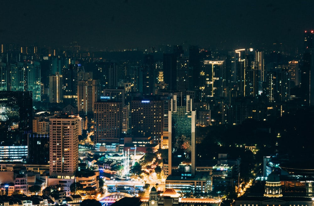 aerial photography of city buildings at night