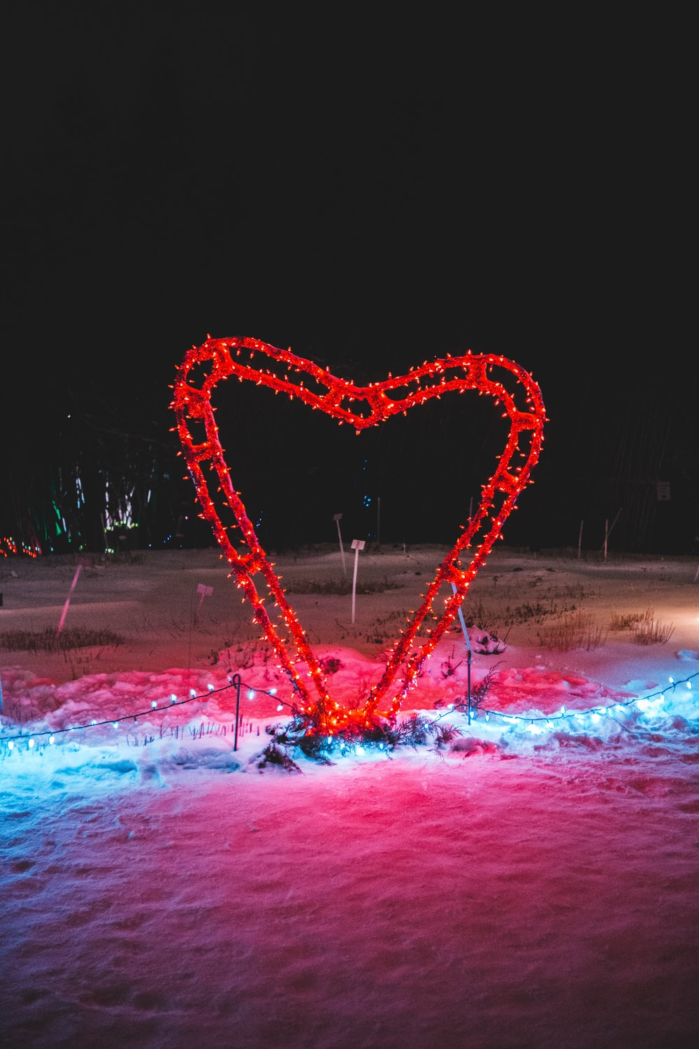 red heart on snow at night