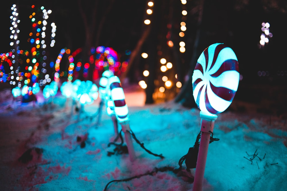 turned-on candy lights on snow at night