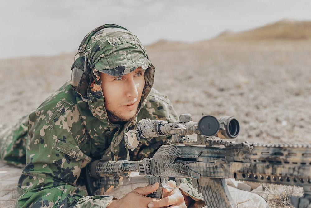 man holding sniper rifle