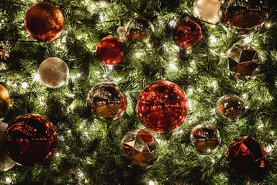 red and yellow bauble ball on the christmas tree christmas tree teams background