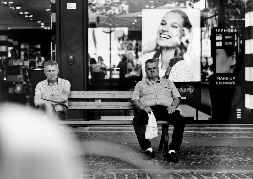 two man sitting on the bench