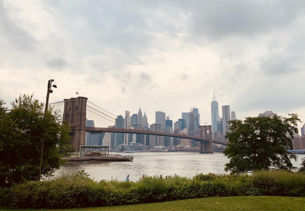 Brooklyn bridge and cityscape under white sky