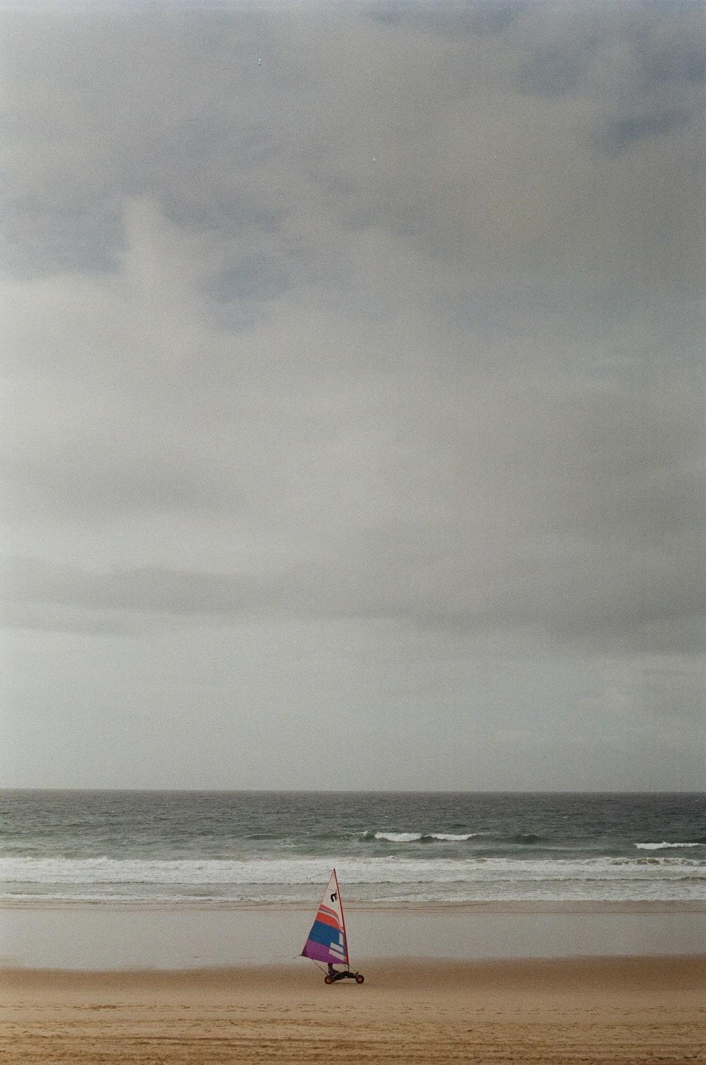 banner on seashore during daytime