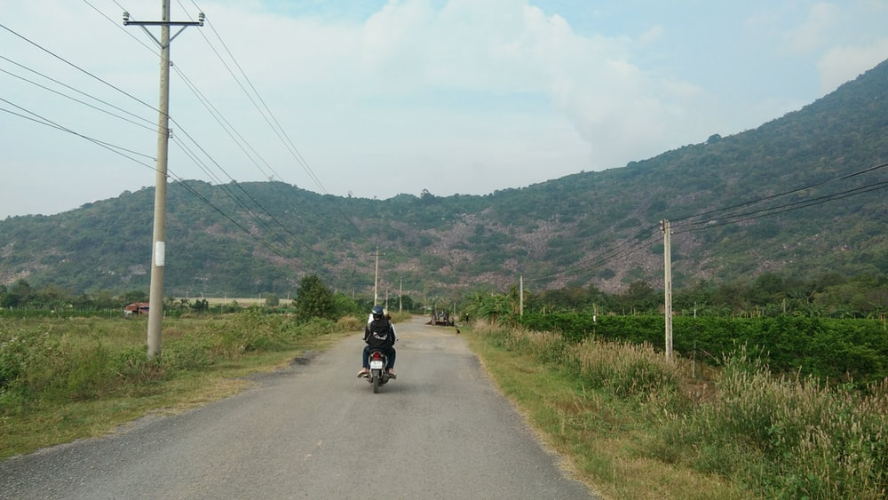 person riding motorcycle photograph