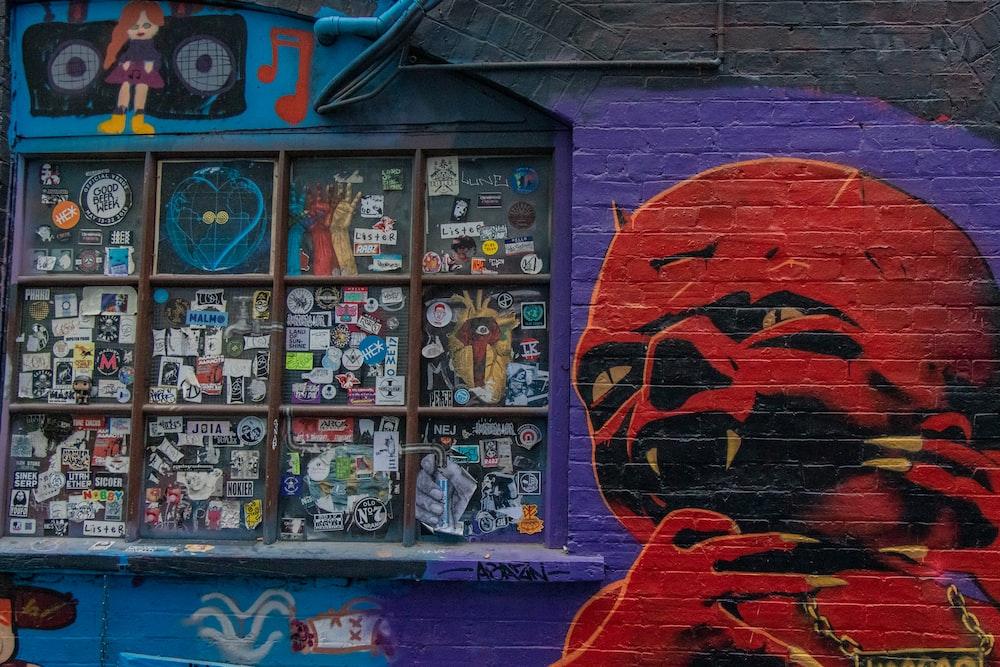 devil graffiti beside window