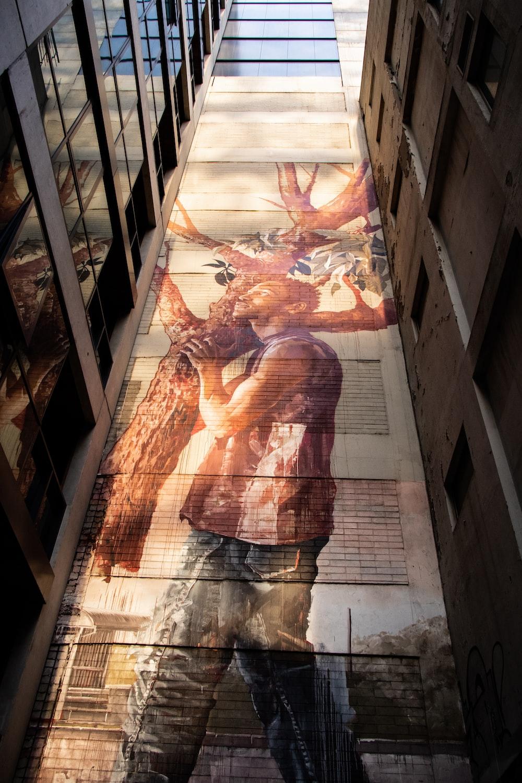 man carrying cut tree graffiti