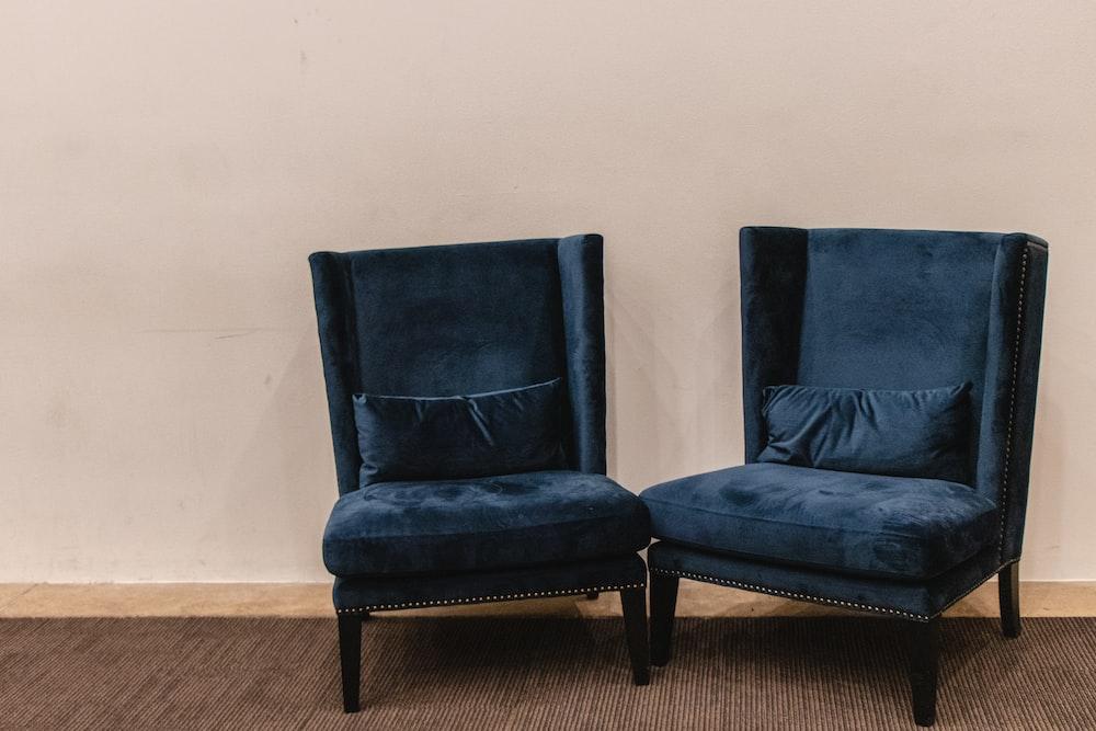 two blue velvet chairs