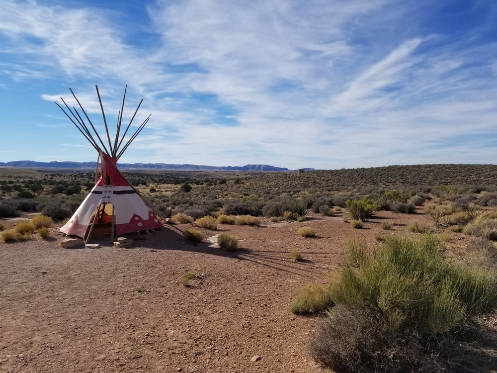 white and red striped tipi hat during daytime