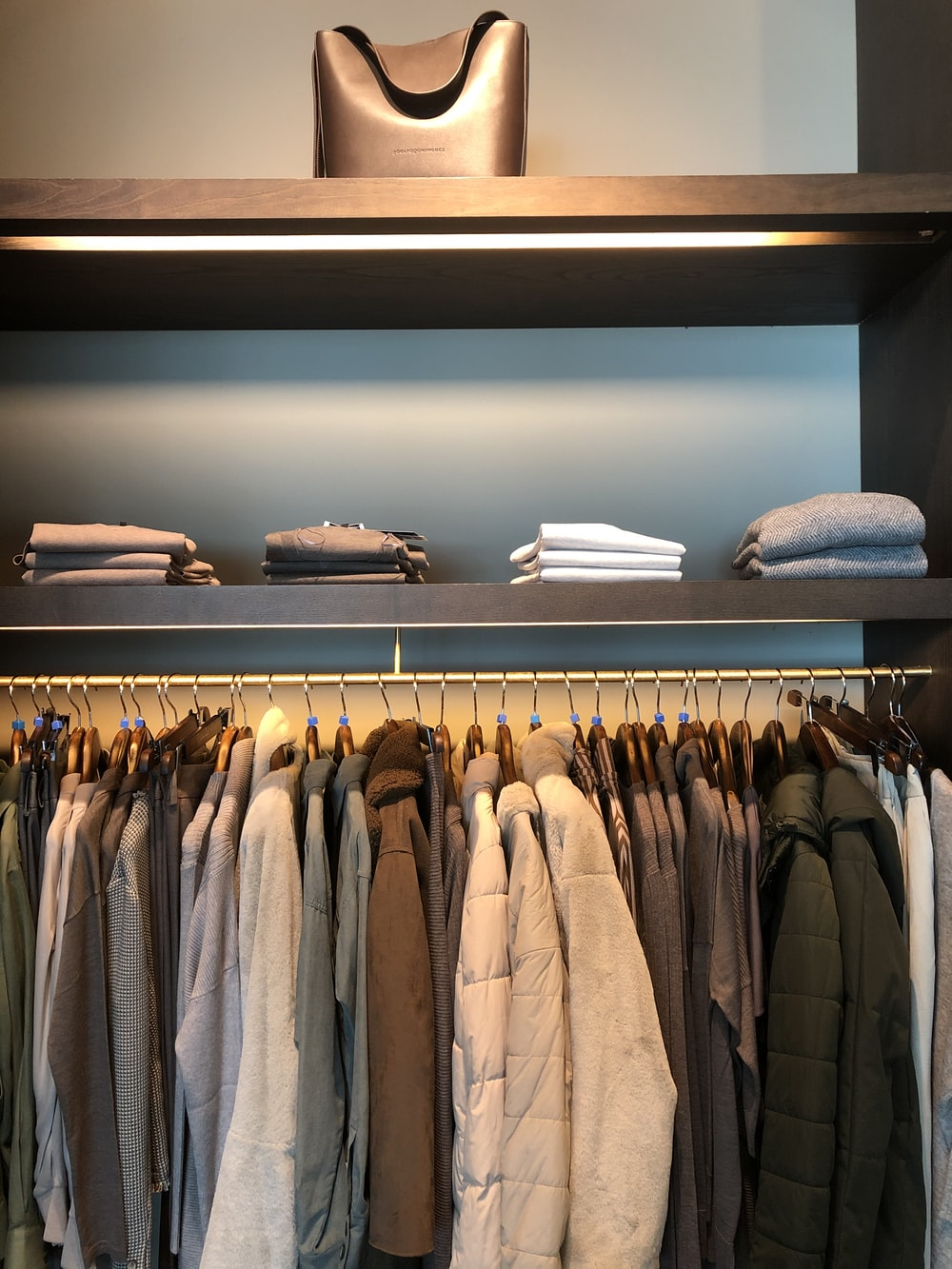 folded clothes above hanged clothes