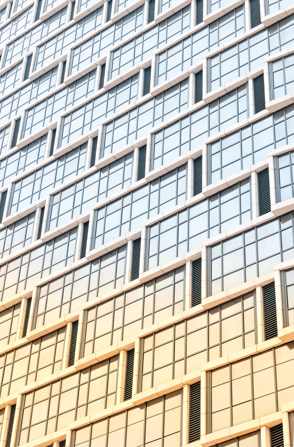 low-angle photography of curtain wall high-rise building