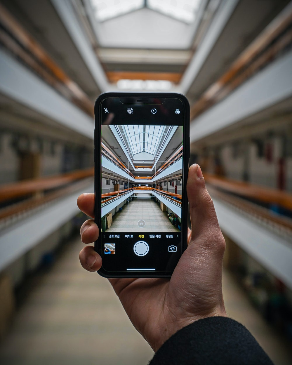 shallow focus photo of person taking photo using smartphone