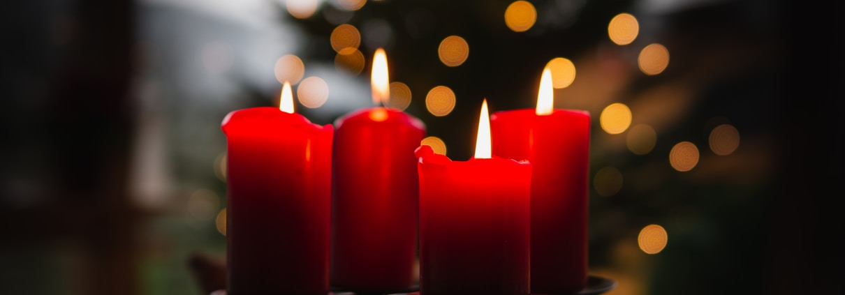 shallow focus photo of four red lighted candles