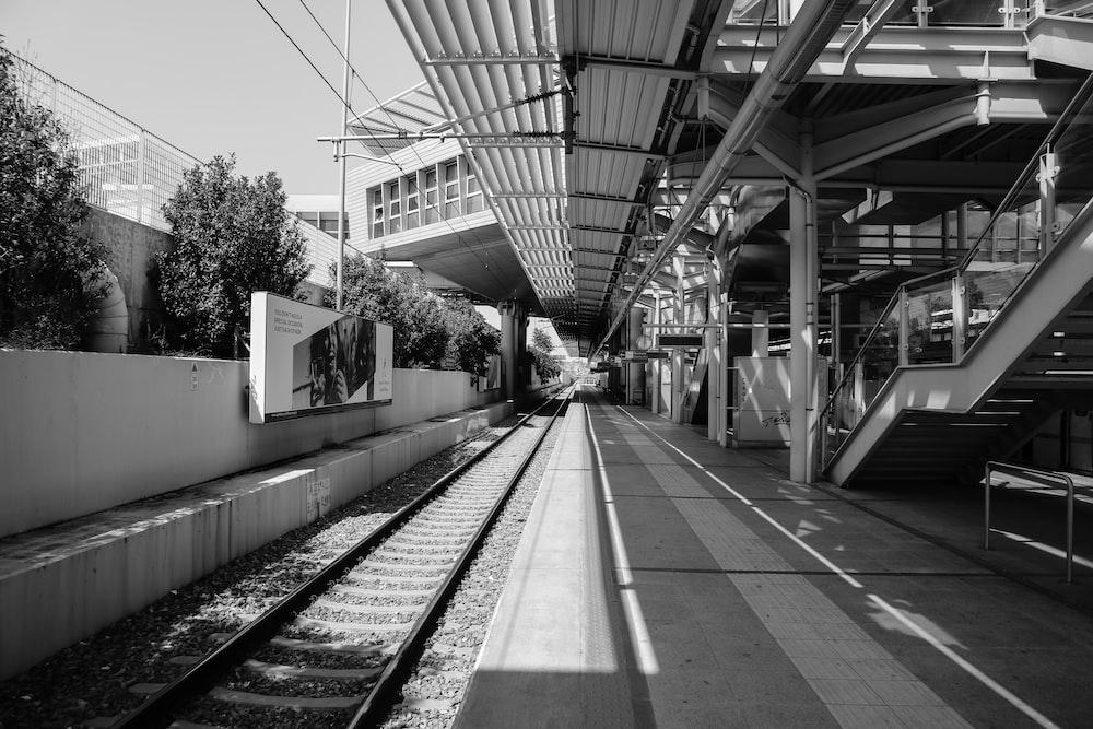 grayscale photo of railroad