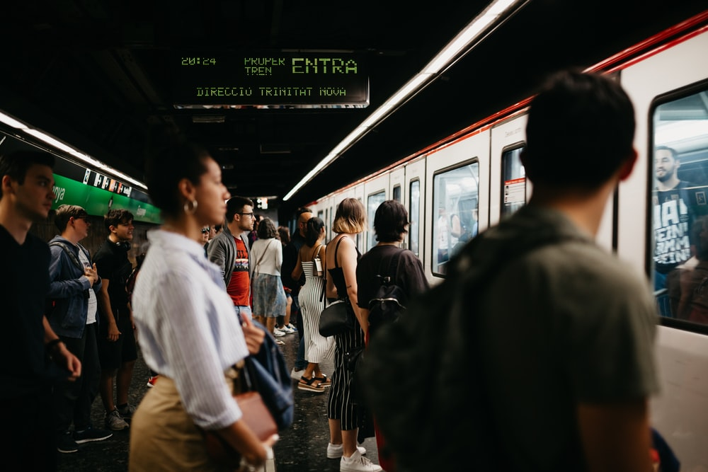 people standing on white train