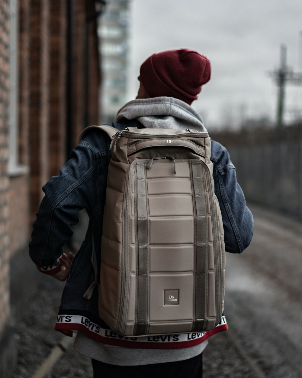 person wearing grey backpack