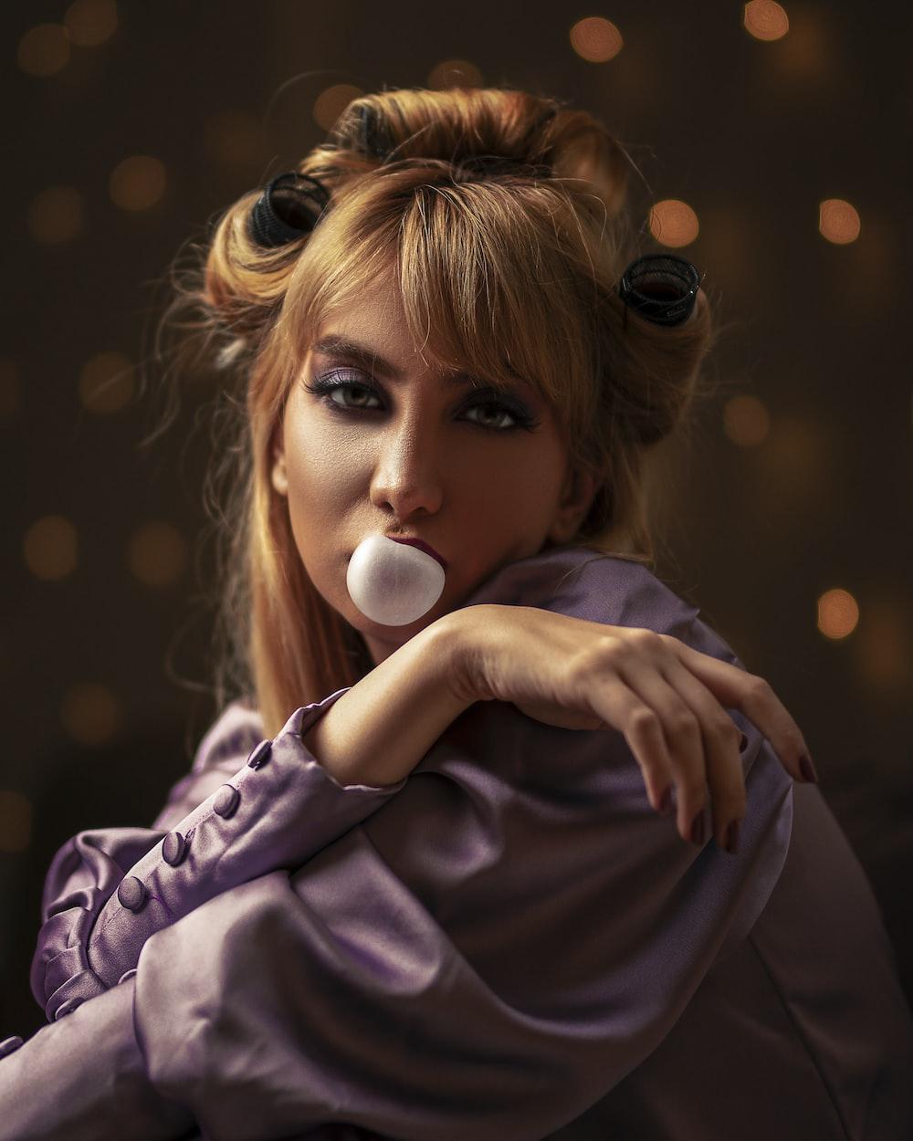 woman wearing purple top