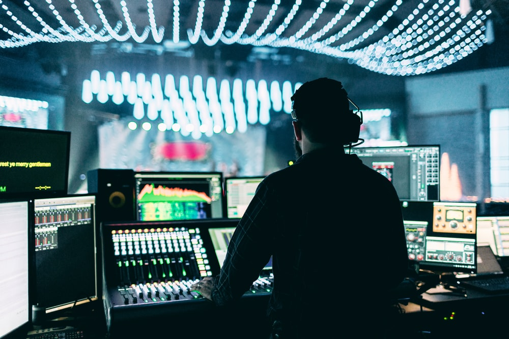 silhouette of man using audio mixer