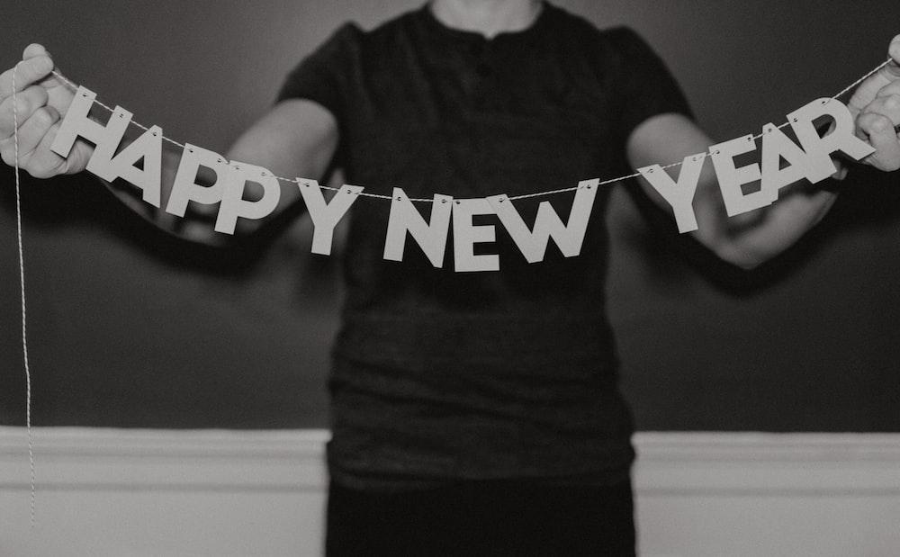 man holding happy new year decor
