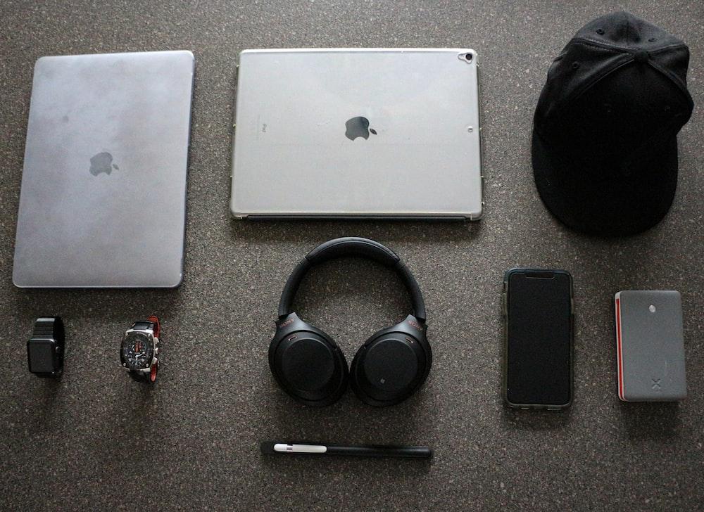 black wireless headphones beside iPad