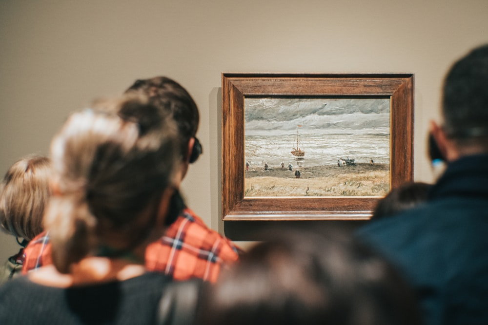 people standing while watching on Beach at Scheveningen in Stormy Weather painting by Vincent Van Gogh
